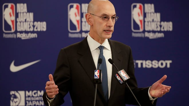 FILE - In this Oct. 8, 2019, file photo, NBA Commissioner Adam Silver speaks at a news conference before an NBA preseason basketball game between the Houston Rockets and the Toronto Raptors in Saitama, near Tokyo. The NBA and the National Basketball Players Association have finalized terms of the deal that will allow the league to restart the season at the Disney World campus near Orlando, Florida next month.