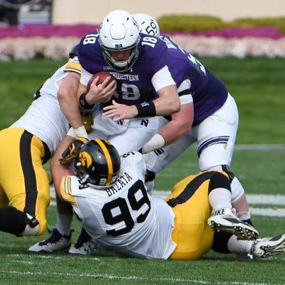 Iowa defensive tackle Nathan Bazata (99) brings down