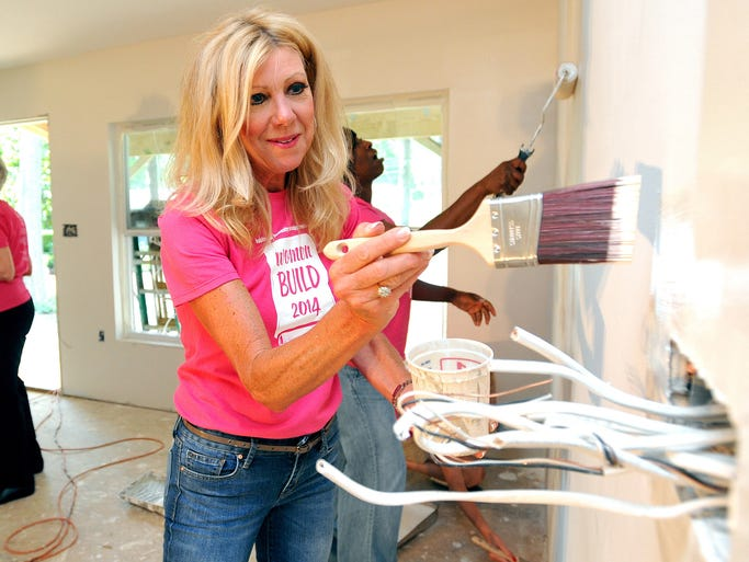 Jill Beneke, co-chair of the Habitat for Humanities Women Build 2014, paints a wall Saturday at habitat home at 4304 Oakhill Drive in Jackson.