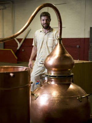 James Yoakum, shown in 2012, will close Cooper River Distillers in early May.