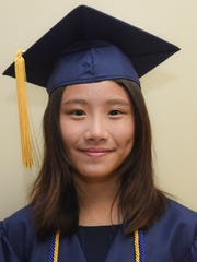 "Jia Jia Zhang, salutatorian of the St. John's School class of 2016. ""Face forward, and chase your dreams."""
