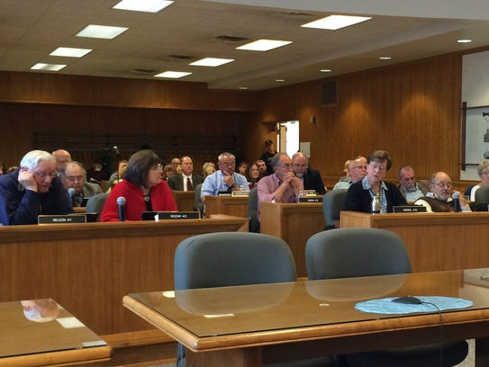 Members of the Wood County Board deliberate Tuesday