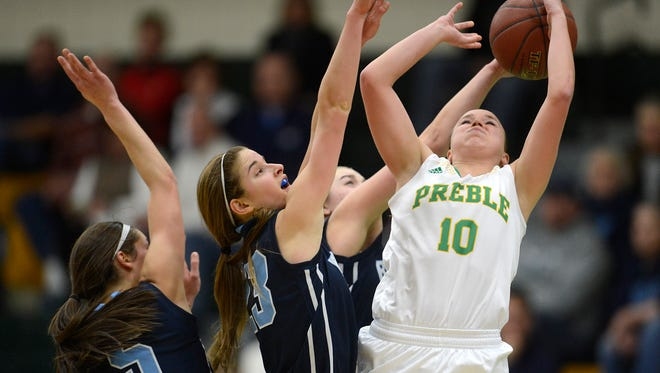 Green Bay Preble's Tavia Anderson (10) has her shot blocked by Bay Port's Mackenzie Jerks (1) during Friday night's girls basketball game at Green Bay Preble High School. Also shown on the play are Bay Port's Maddie Re (23) and Alexa Leiterman (5). Evan Siegle/Press-Gazette Media