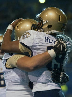 Navy Midshipmen quarterback Keenan Reynolds (right) guided his team to a thrilling triple-overtime win against San Jose State.