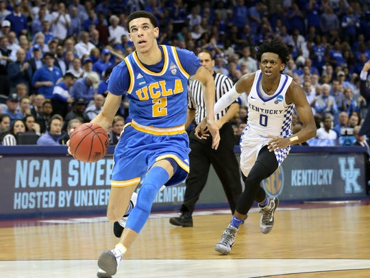 UCLA guard Lonzo Ball drives to the basket past Kentucky