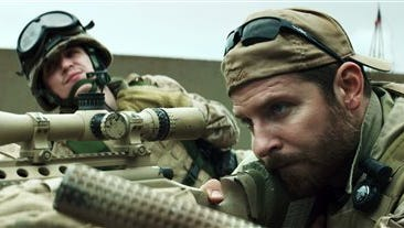 """In this image released by Warner Bros. Pictures, Kyle Gallner, left, and Bradley Cooper appear in a scene from """"American Sniper.""""  The film is based on the autobiography by Chris Kyle."""