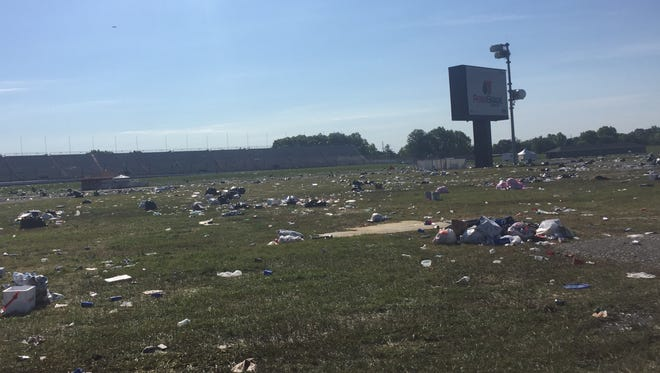 Trash is scattered across the infield at the Indianapolis Motor Speedway after the Indy 500.