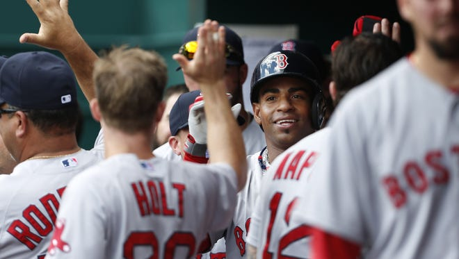 Boston Red Sox left fielder Yoenis Cespedes (52) was all smiles after scoring on a two-run home run by first baseman Mike Napoli (12) in the fifth inning at Great American Ball Park.