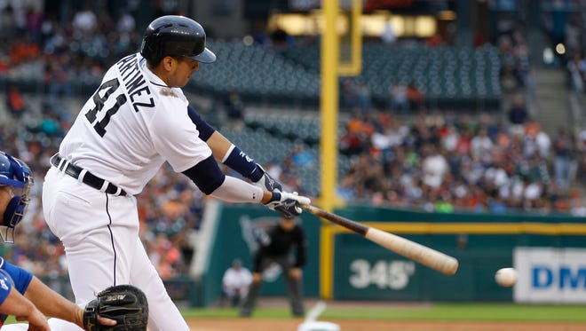 Tigers first baseman Victor Martinez hits a two-out single in the first inning of the Tigers' 4-0 win Thursday at Comerica Park.