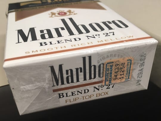 Legally sold cigarettes have a stamp affixed to the box that show the wholesaler paid the state taxes on the cigarettes. This spring, Delaware is considering raising the tax on a pack of cigarettes by $1 to $2.60.