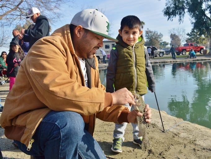 Plaza Park in Visalia welcomed 200 children to fish