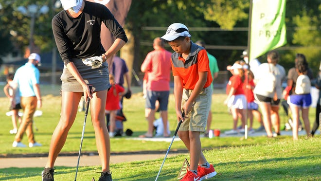 All-Pro Tour golfer Karah Sanford of Sevierville, Tenn., instructs Nam Nguyen, 9, during a junior clinic on Tuesday evening, August 5, 2020, at Hardscrabble Country Club. The APT-United Way Charity Classic Golf Tournament runs through Saturday. Nam was at the course with his father Phat Nguyen.