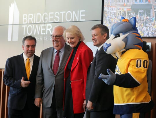 Predators mascot Gnash takes the stage to help with the announcement that Bridgestone is extending its naming rights agreement for Bridgestone Arena by five years during an event Wednesday at the Bridgestone Tower.