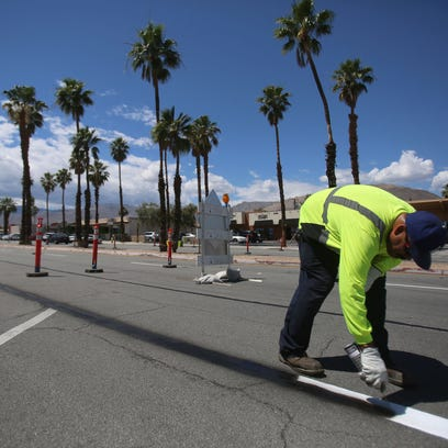 A temporary roundabout is in place at San Pablo Ave. and San Gorgonio Way on Monday, May 2, 2016, in Palm Desert, Calif. The city is temporarily widening pedestrian areas along the street and removing one lane in each direction to demonstrate its Vision San Pablo concept as part of the city's general plan update.