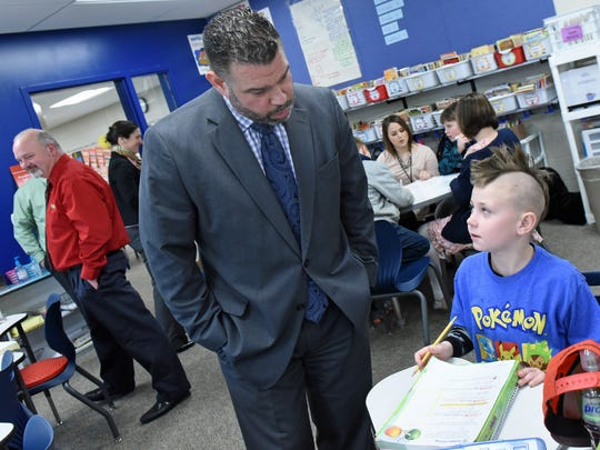 Pedro Rivera, left, Pa. education secretary, chats with student Jaydin Pepple at Greencastle-Antrim Elementary School on Tuesday, February 14, 2017. Sec. Rivera was in Greencastle for the Schools That Teach tour.