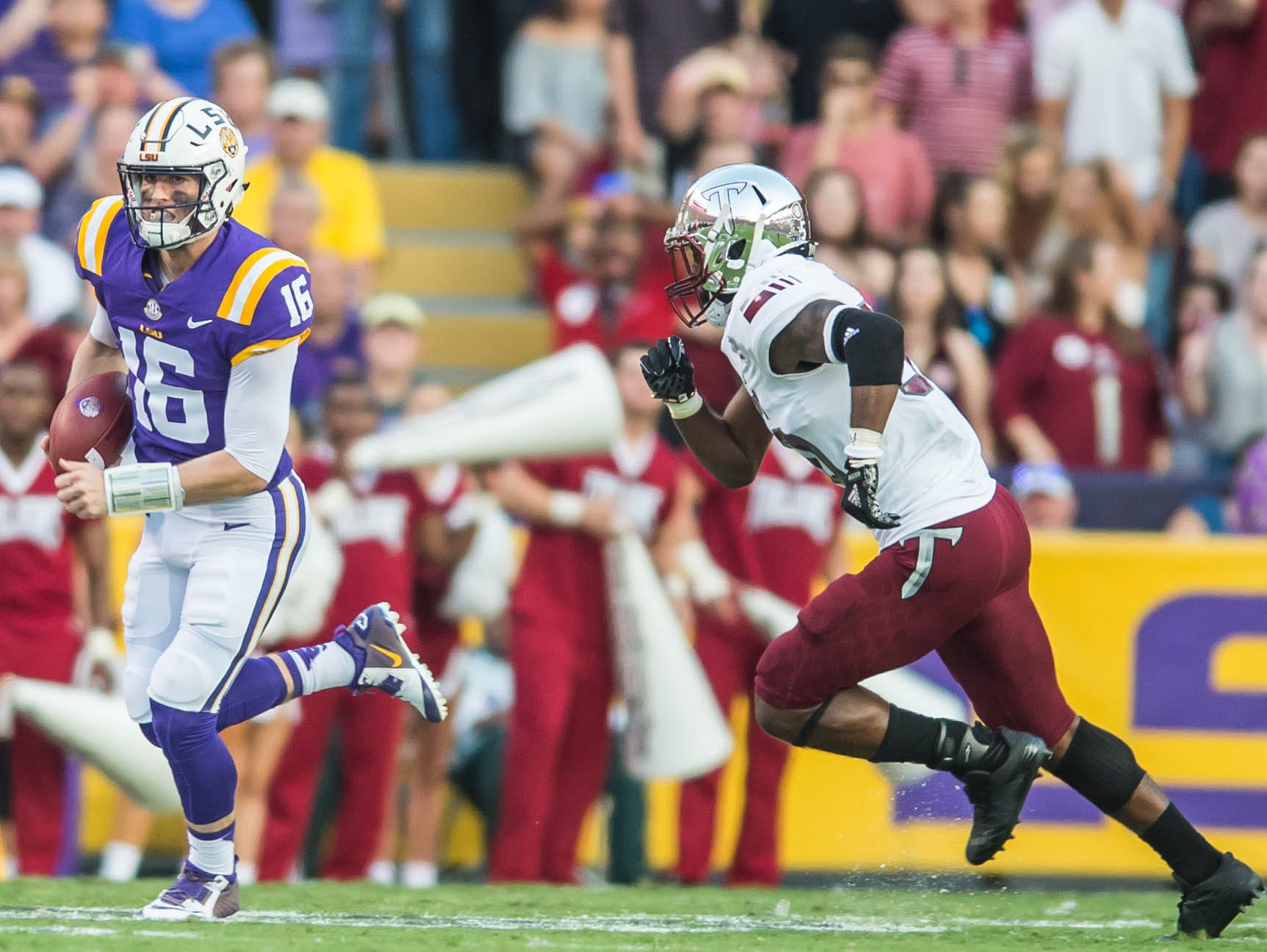LSU Tigers quarterback Danny Etling (16) with the quarterback keeper and gets the first down as the LSU Tigers take on the Troy Trojans in a non-conference contest on Saturday Sept. 30, 2017.