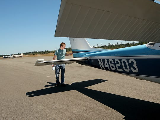 Bremerton Pilots Association scholarship recipient Aidan Hurley goes through his pre-flight checklist prior to a flight at the Bremerton National Airport on Monday.