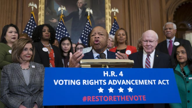 Rep. John Lewis, D-Ga., speaks at an event with House Democrats before passing the Voting Rights Advancement Act to eliminate potential state and local voter suppression laws, at the Capitol in Washington on Dec. 6. Lewis died July 17.