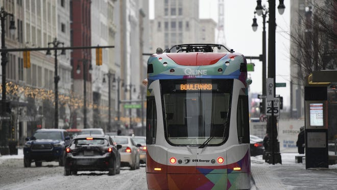 The QLINE makes its way through the snow up Woodward Ave. in downtown Detroit as a winter storm hits Michigan on Monday, Jan. 28, 2019.
