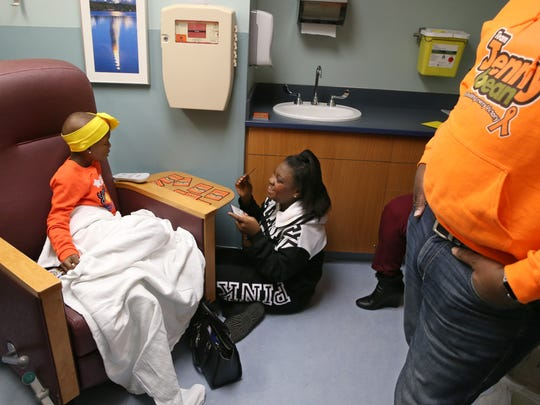 Jenesis Shaw, 8, left, plays Go Fish with sister Trinity Shaw during her treatment for kidney cancer at the Golisano Children's Hospital in Rochester Friday, Nov. 10, 2017.