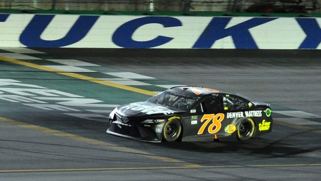 Martin Truex Jr.  crosses the finish like to win the Quaker State 400 at Kentucky Speedway.