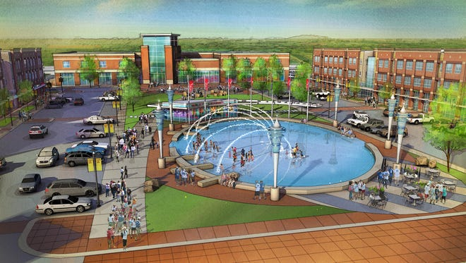 Plans call for a fountain that would be converted to a skating rink in the winter would sit at the center of a retail center at Waukee's new Kettlestone development.