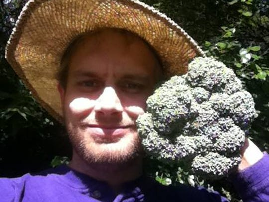 Daniel Heldt of Dangood Gardens in Johnston shows off