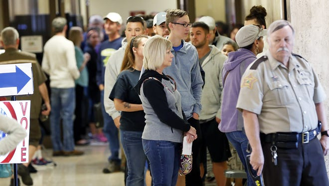 Voting lines Monday at the Clark County Government Building stretch to the sheriff's department from the county clerk's election office, where voters cast their early ballots. Nov. 7, 2016