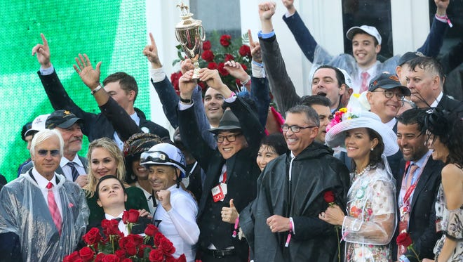 Teo Ah Khing, center, one of the owners of Justify, celebrated in the winner's circle after jockey Mike Smith rode Justify to win the Kentucky Derby at Churchill Downs. May 5, 2018