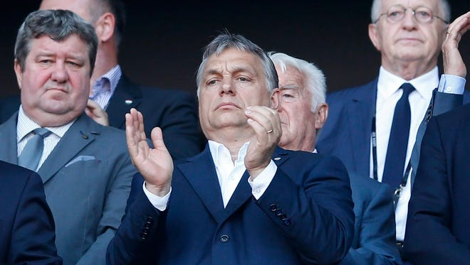 Hungarian Prime Minister Viktor Orban attends a soccer match between Hungary and Portugal in Lyon, France, June 22, 2016.