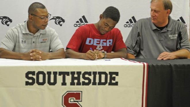 Southside's Kevin Laby signs a scholarship with Talladega College as he is seated next to Talladega coach Joe Tibbs, left, and Southside coach Randy Vice at Southside Baptist Church on Tuesday, June 23, 2020.
