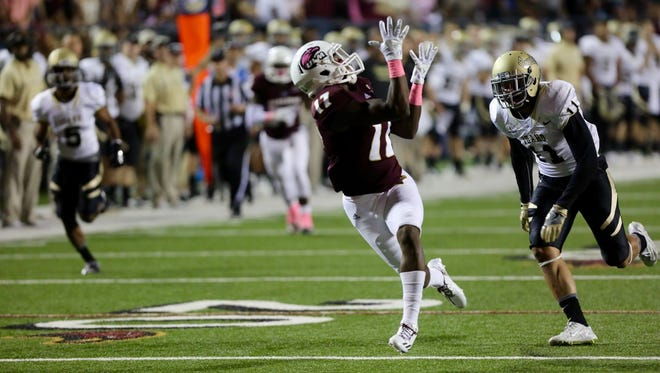 ULM's Xavier Brown (17) hauls in a 44-yard touchdown pass from Garrett Smith just before the half against Idaho on Saturday night.