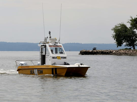 A Sea Tow boat captained by Joe Paccione, motors along