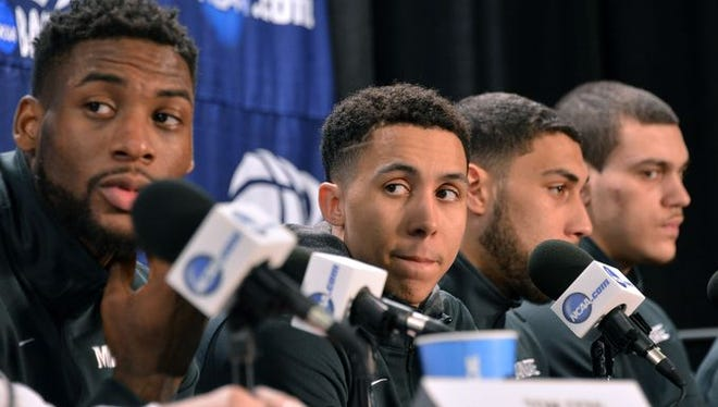 Branden Dawson and Travis Trice listen to a question during Saturday's press conference.