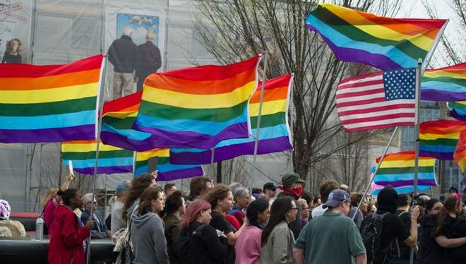 Ashevillians turned out in force and rallied Thursday in Pack Square against House Bill 2, which overrides local LGBT nondiscrimination ordinances in the state.