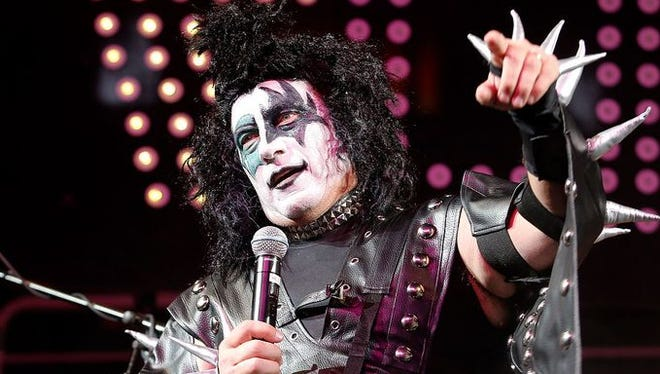 Michigan State coach Tom Izzo talks to the crowd dressed as member of the band Kiss before an NCAA college basketball scrimmage, Friday, Oct. 24, 2014, in East Lansing, Mich.