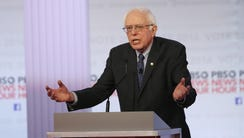 Bernie Sanders participates in the PBS NewsHour debate