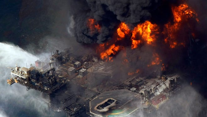 The Deepwater Horizon oil rig burns April 21, 2010 in the Gulf of Mexico more than 50 miles southeast of Venice, La.
