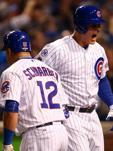 Anthony Rizzo celebrates with Kyle Schwarber after