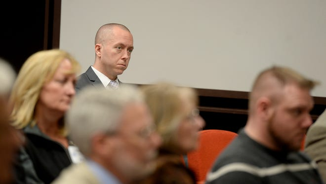 Richmond Mayor Dave Snow listens along with others as the Wayne County commissioners host a public hearing on the county's proposed needle exchange program Wednesday, March 30, 2016, in the Wayne County Administration Building.