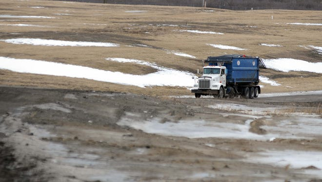 A trash truck drives up the road in February 2013 at the Smiths Creek Landfill to dump a load of garbage.