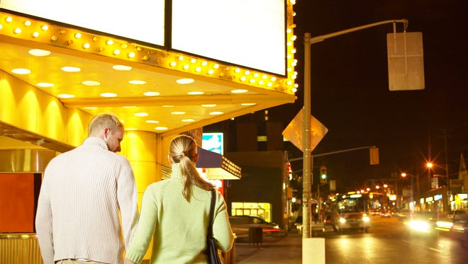 Couple walking to theater