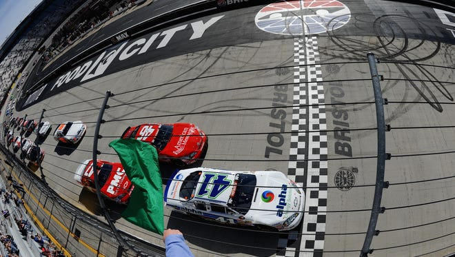 BRISTOL, TN - MARCH 15: Ben Rhodes, driver of the #41 Alpha Energy Solutions Chevrolet, leads the pack through the green flag to start the NASCAR K&N Pro Series East PittLite 125 at Bristol Motor Speedway on March 15, 2014 in Bristol, Tennessee.  (Photo by Jonathan Moore/NASCAR via Getty Images) *** Local Caption *** Ben Rhodes