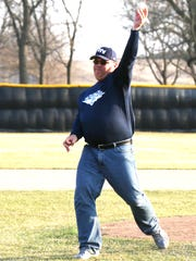 Jake  Foehrenbacher's dad, Don, throws out the first pitch to Jake's younger brother, Alex, on Thursday in Eden Valley.