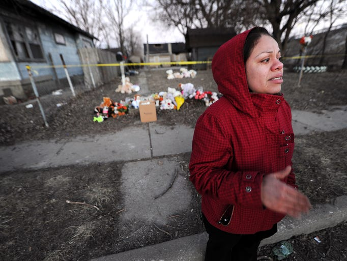 Carmen Tello, aunt to the children of the Guerra family, speaks about organ donations after a vigil, Wednesday, February 26, 2014, for the Guerra family who died as a result of a fire inside their Olney Street home in Indianapolis.