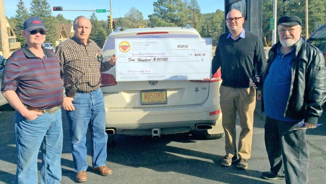 An oversized check marks the award of a $500 grant to the Sierra Blanca Amateur Youth Project from the Community Foundation of Lincoln County. From left are Henry Hunter and Harvey Foster,  SBARC members, Community Foundation of Lincoln County Board Member Leroy Smith and SBARC President Richard Brown.