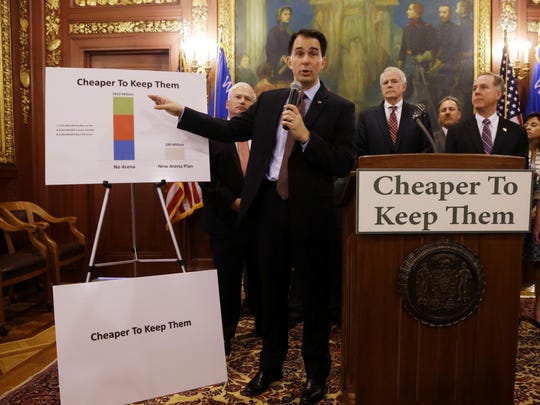 Gov. Scott Walker talks about a deal to pay for a new arena for the Milwaukee Bucks at a news conference June 4 in Madison. Taxpayers would pick up half the cost of a new $500 million arena for the NBA basketball team under a financial deal that would rely on current and former team owners for the rest.