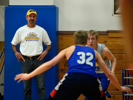 Jay Davison watches the Highwood boys' basketball team prepare for the State C tourney.