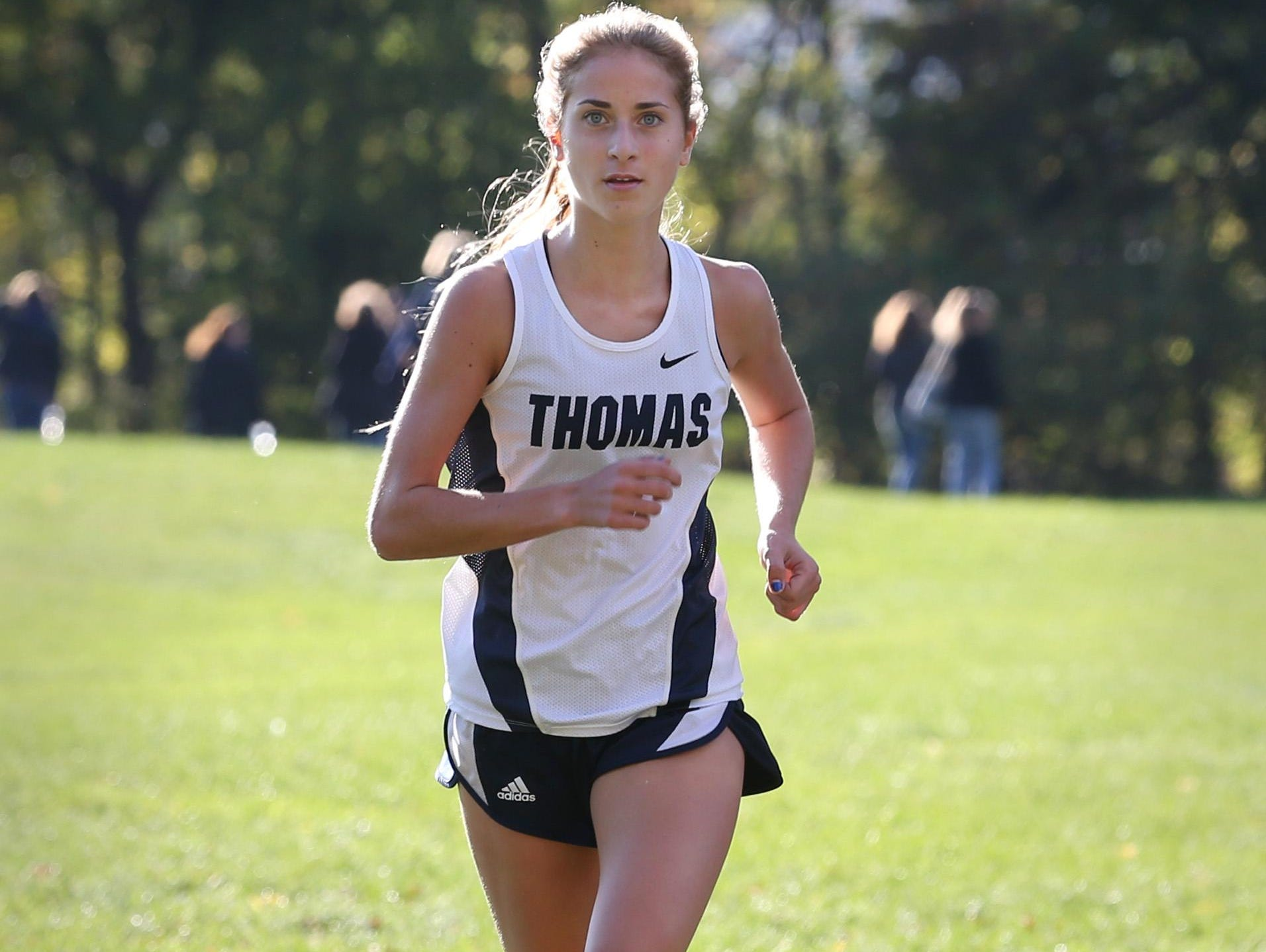Amanda Vestri, Webster Thomas, runs away from the field early on her way to winning the girls race during their Section V cross country meet at Mendon Ponds Park in Mendon on Thursday.