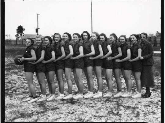"""A photo of a girls basketball team from the days of yore is among the items in the """"Hometown Teams"""" exhibit."""